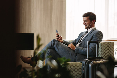 Business executive making a video call at airport lounge