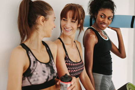 Friends in gym chatting after workout