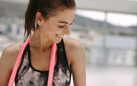 Relaxed female after her workout at gym