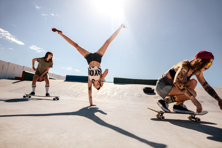 Female skaters enjoying at skate park