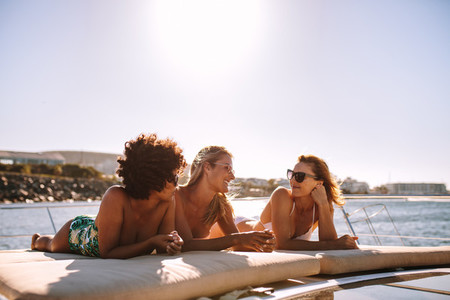 Female friends relaxing on a yacht deck