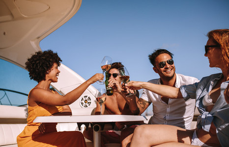 Friends partying on a boat with drinks