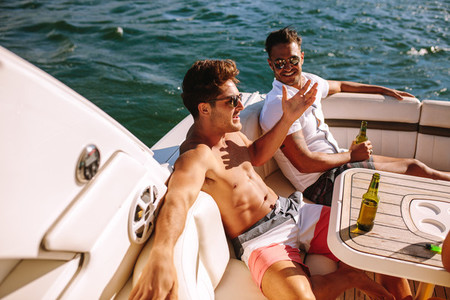 Friends partying in a yacht