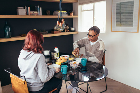 Couple having breakfast together at home