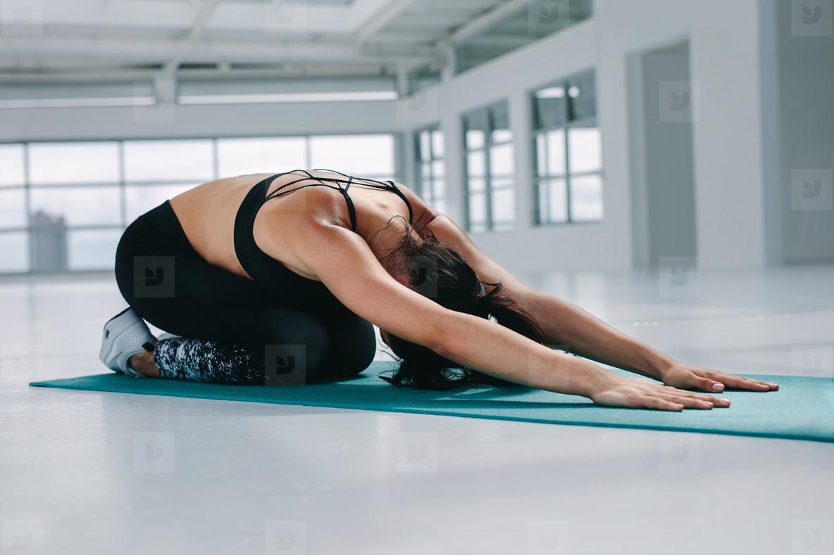 Flexible woman performing yoga
