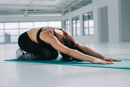 Flexible woman performing yoga