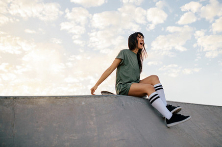 Woman enjoying a day at skate park