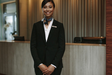 Female concierge ready to welcome guest