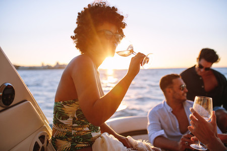 African woman partying with friends in boat