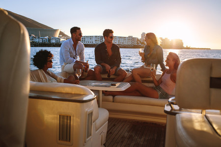 Friends having boat party at sunset