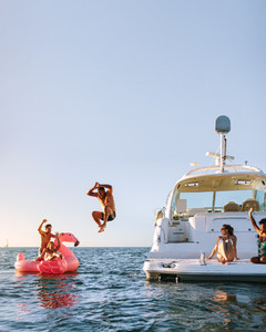 Young people having fun during party on a private boat