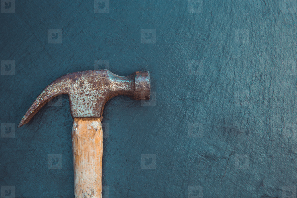Old hammer tool on dark background