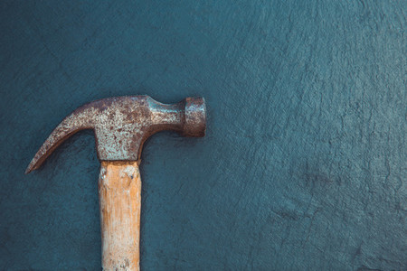 Old hammer tool on dark background