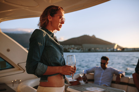 Woman partying with friends at private yacht