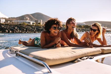 Women friends relaxing on a private yacht deck