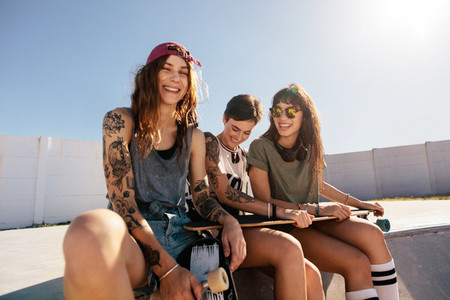 Beautiful woman at skate park with friends