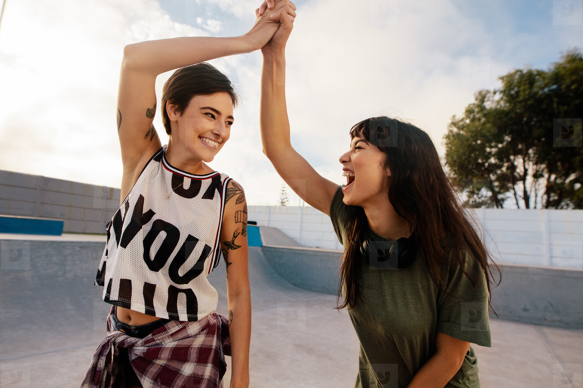 Skaters high five at skate park