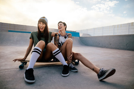 Female skaters friends hangout at skate park