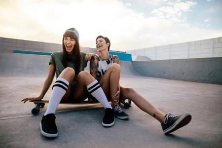 Female skaters friends hangout at skate park