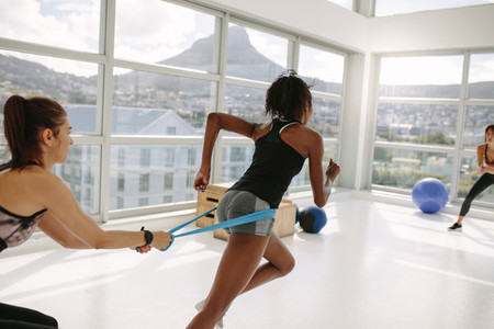 Women at gym during resistance band workout