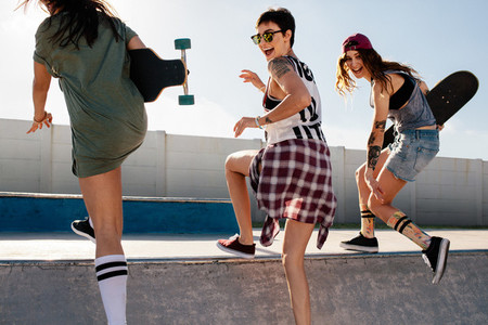 Group of girls having a great time at skate park