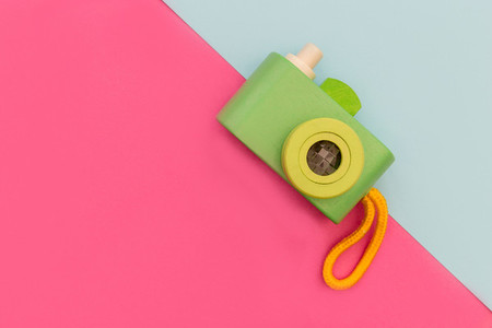 Retro camera on pink and blue background