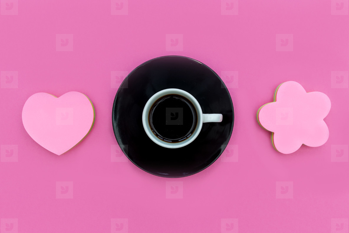 Coffee cup  saucer with love heart on pink background