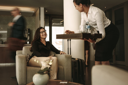 Business traveler at airport waiting lounge