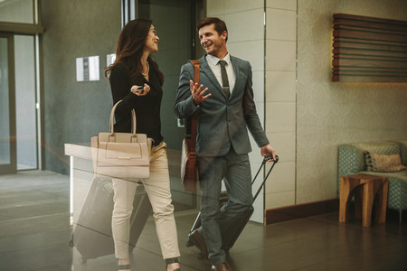 Business partners walking through airport lobby