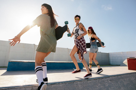 Group of women skaters enjoying at skate park