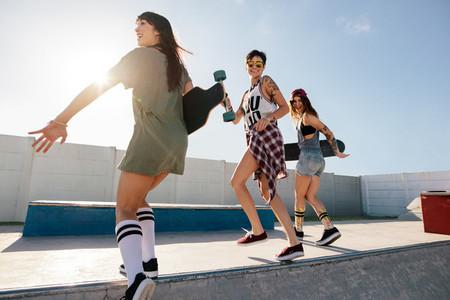 Group of women skaters enjoying at skate park