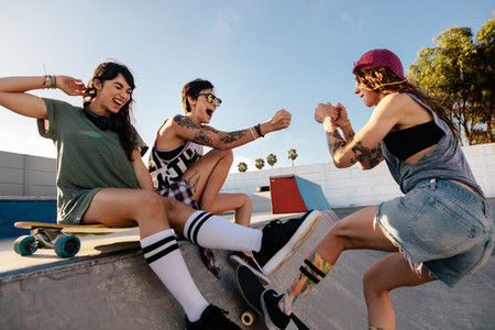 Young women having a great time at skate park