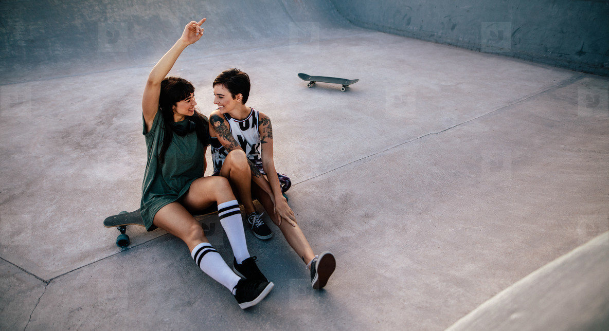 Female friends hanging out at skate park