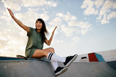 Woman skateboarder enjoying a day at skate park