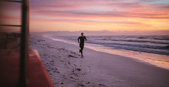 Man running on the beach in morning
