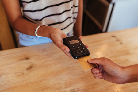 Woman making a wireless card transaction payment