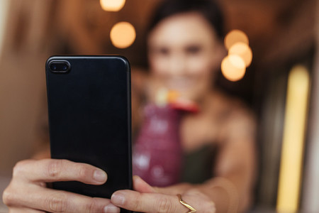 Woman taking a selfie for her blog