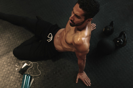 Man relaxing on floor after training