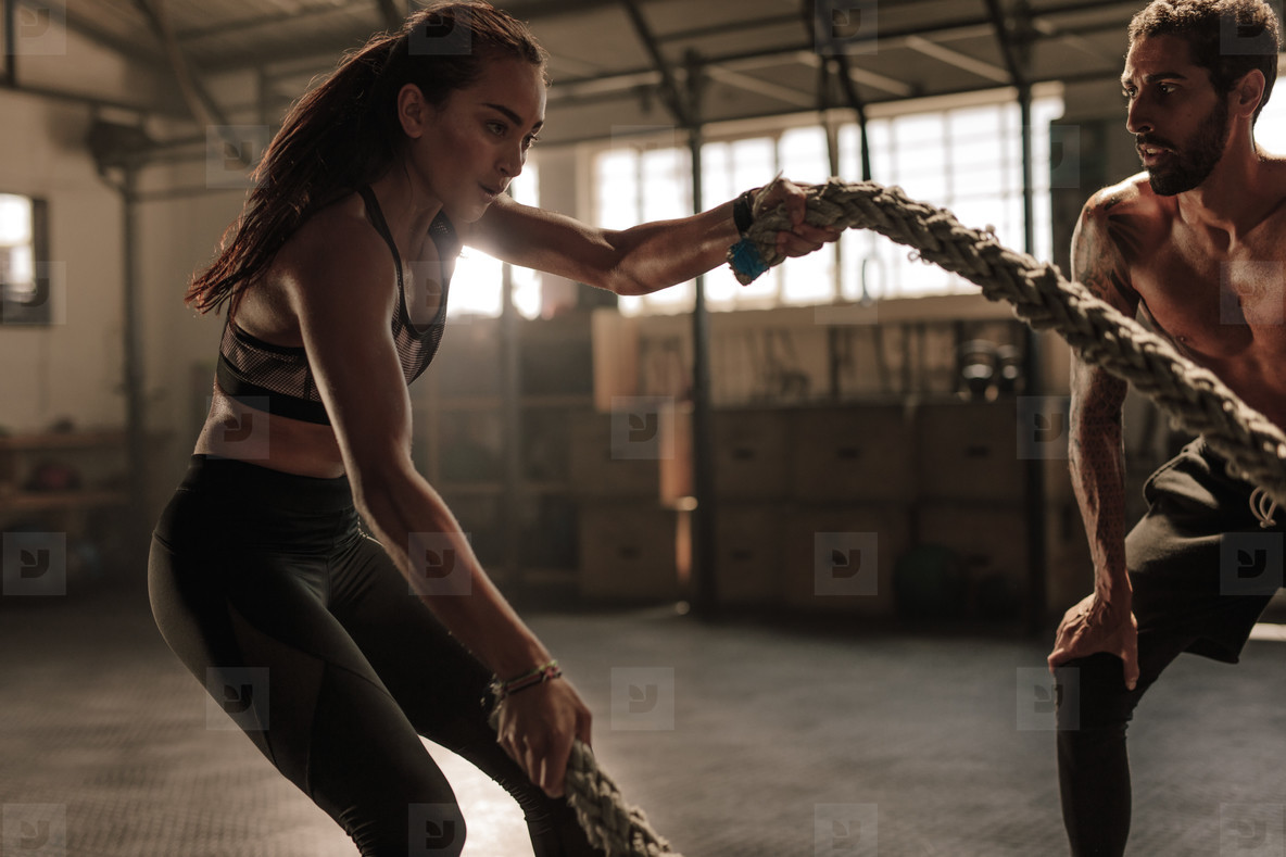 Strong woman workout with battle ropes