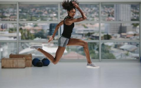 Sporty woman doing intense exercises
