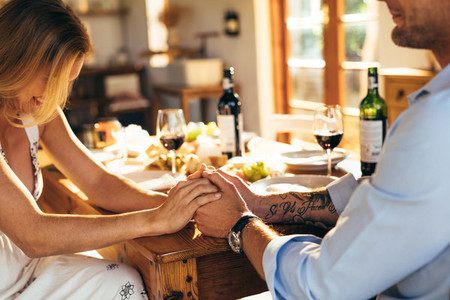 Couple having romantic meal at home