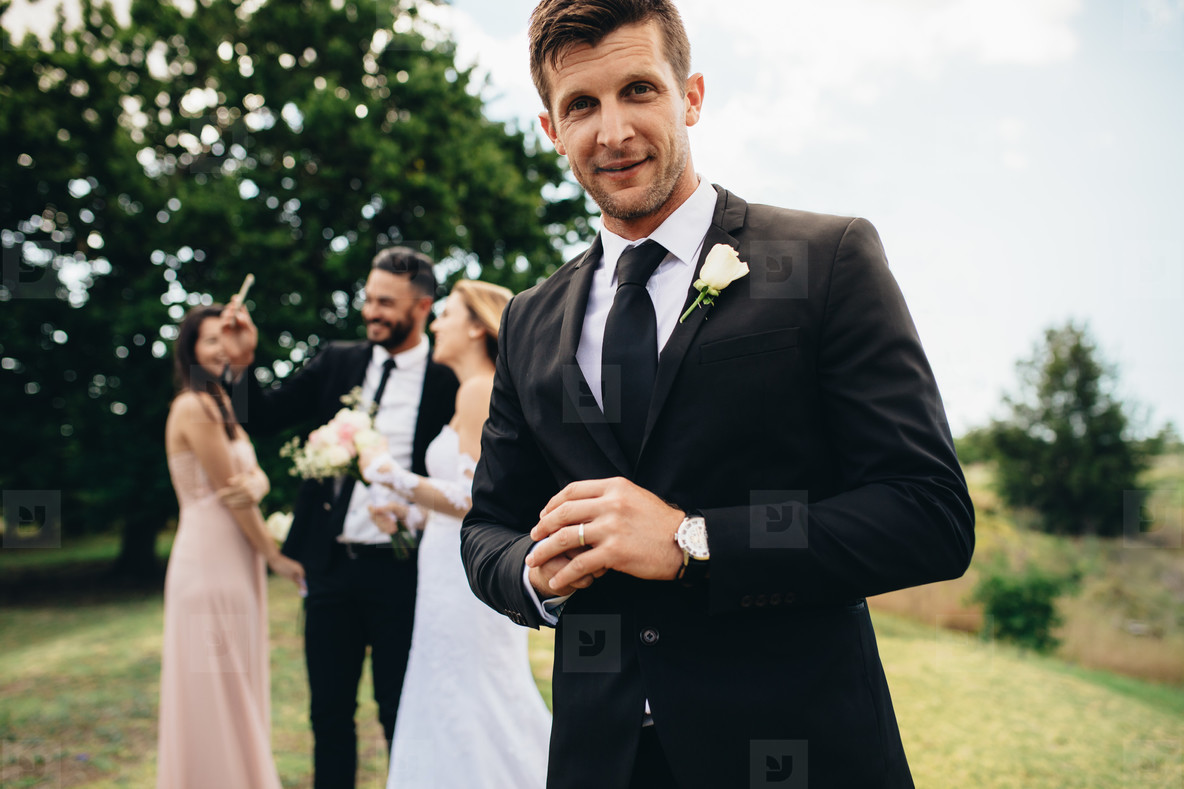 Handsome groom looking happy on his wedding day