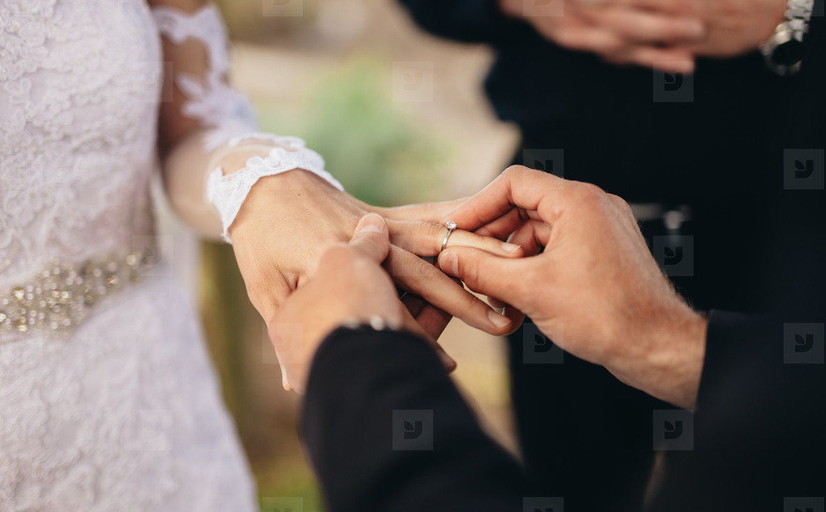 Couple exchanging wedding rings
