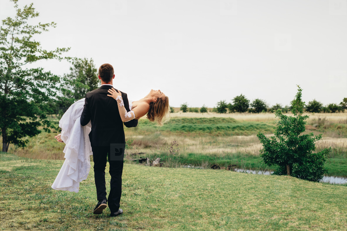 Newlywed couple at park