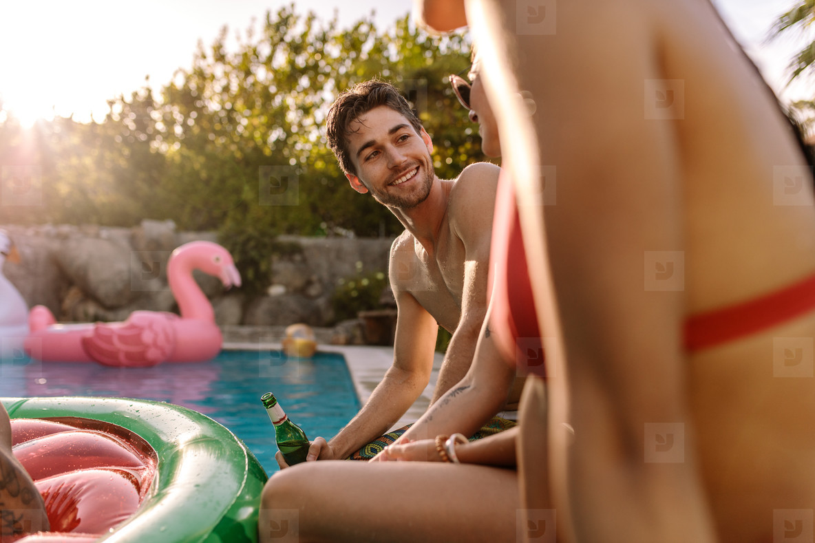 Young people having pool party