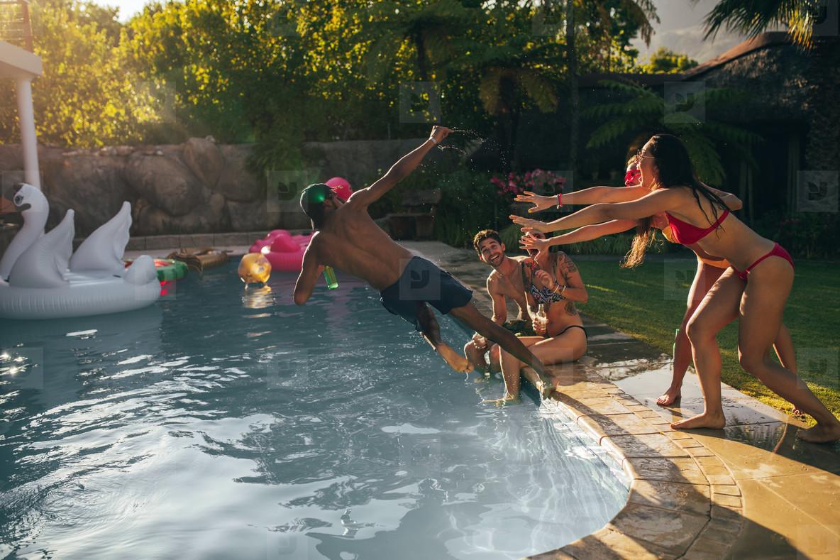 Friends enjoy pool party in summertime