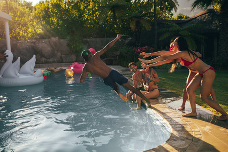 Friends enjoy pool party in summertime