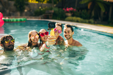 Group of friends catching memories from pool party