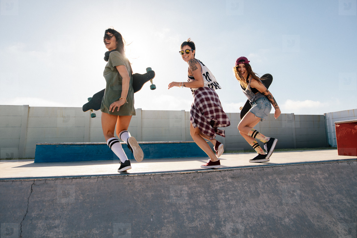 Group of female friends enjoying at skate park