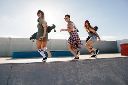 Group of female friends enjoying at skate park